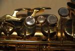 Saxophon mit 4 Perlmuttknöpfen